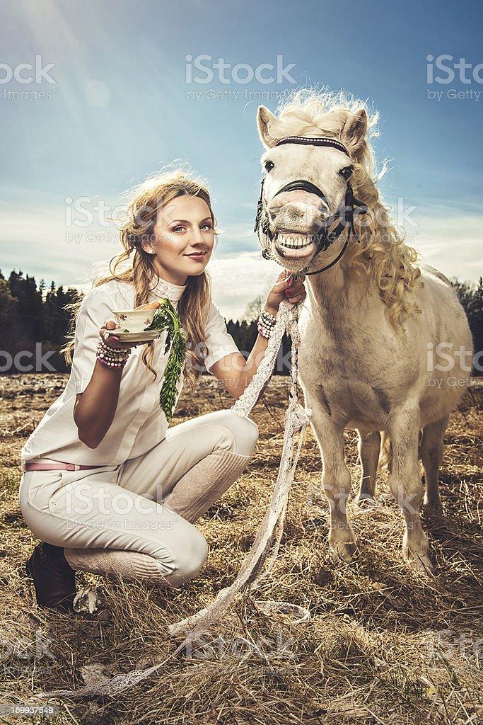 Beautiful woman and a shetland pony stock photo