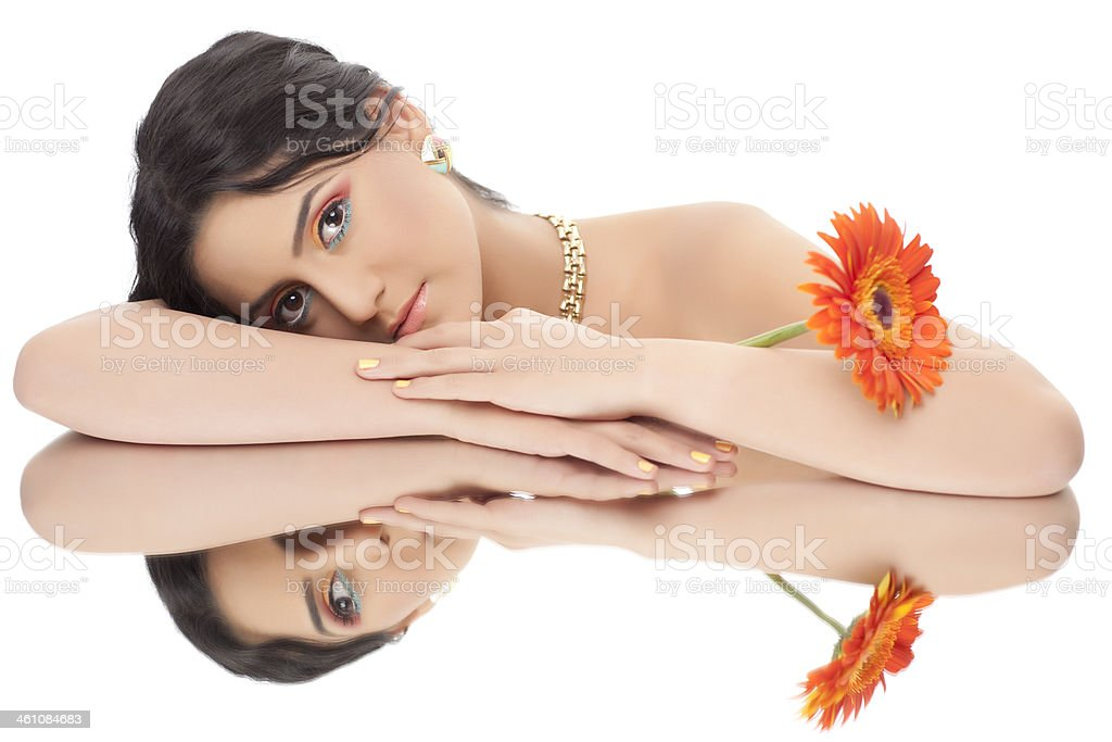 Beautiful woman and her reflection in mirror tabel. royalty-free stock photo