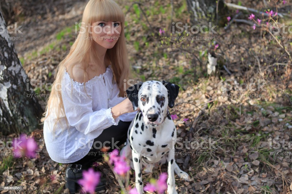 Beautiful woman and his dog posing outside royalty-free stock photo