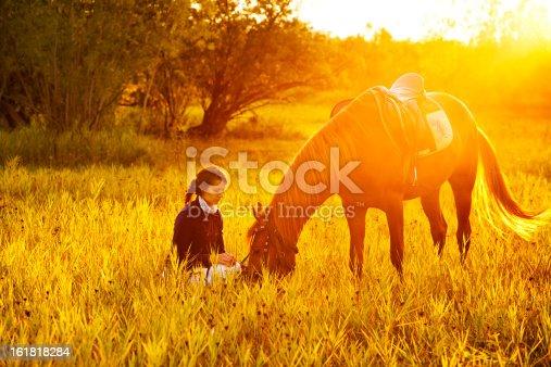 1128475475 istock photo Beautiful woman and  horse 161818284