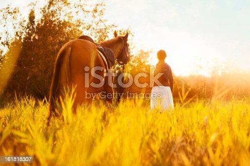 1128475475 istock photo Beautiful woman and  horse 161818307