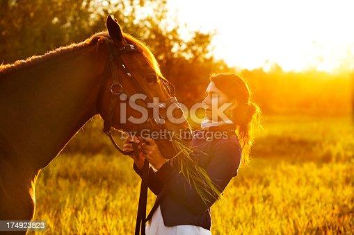 1128475475 istock photo Beautiful woman and  horse 174923823