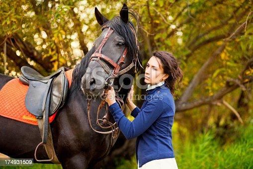 1128475475 istock photo Beautiful woman and  horse 174931509