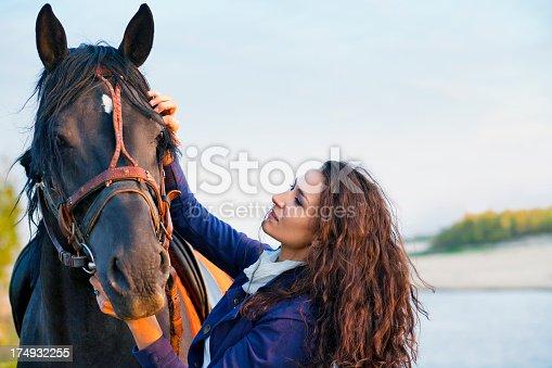 1128475475 istock photo Beautiful woman and  horse 174932255