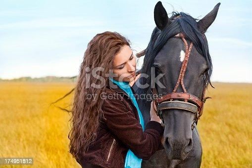 1128475475 istock photo Beautiful woman and  horse 174951812