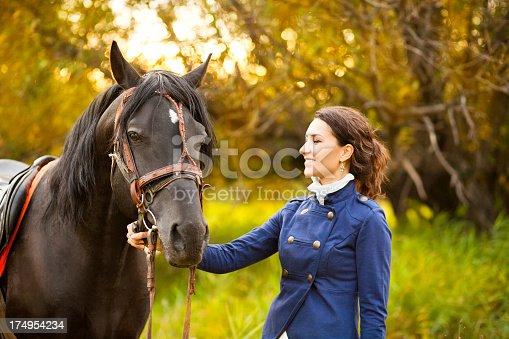 1128475475 istock photo Beautiful woman and  horse 174954234