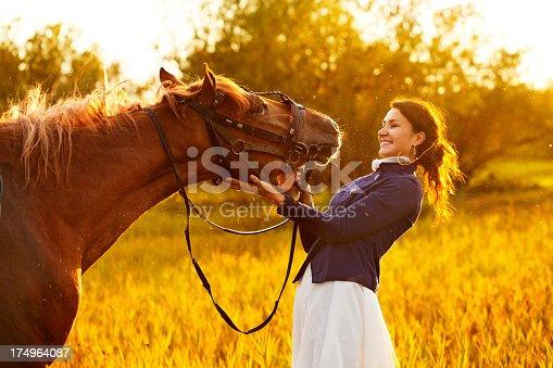 1128475475 istock photo Beautiful woman and  horse 174964087