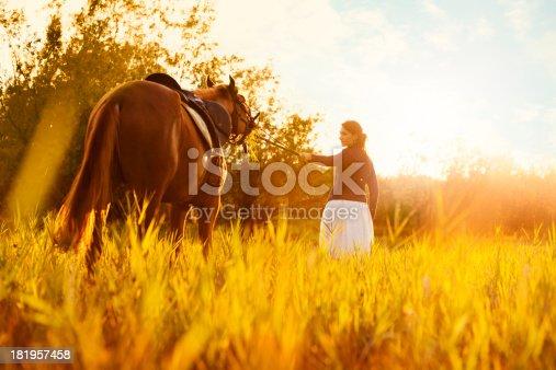 1128475475 istock photo Beautiful woman and  horse 181957458