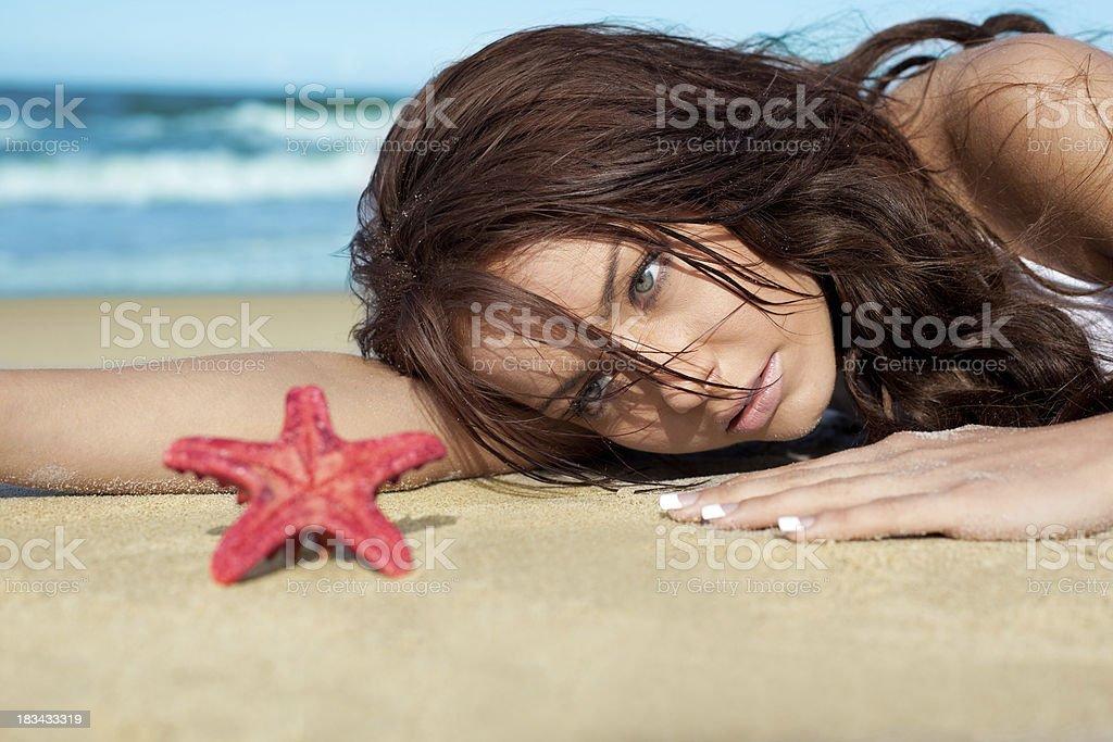 Beautiful woman and starfish royalty-free stock photo