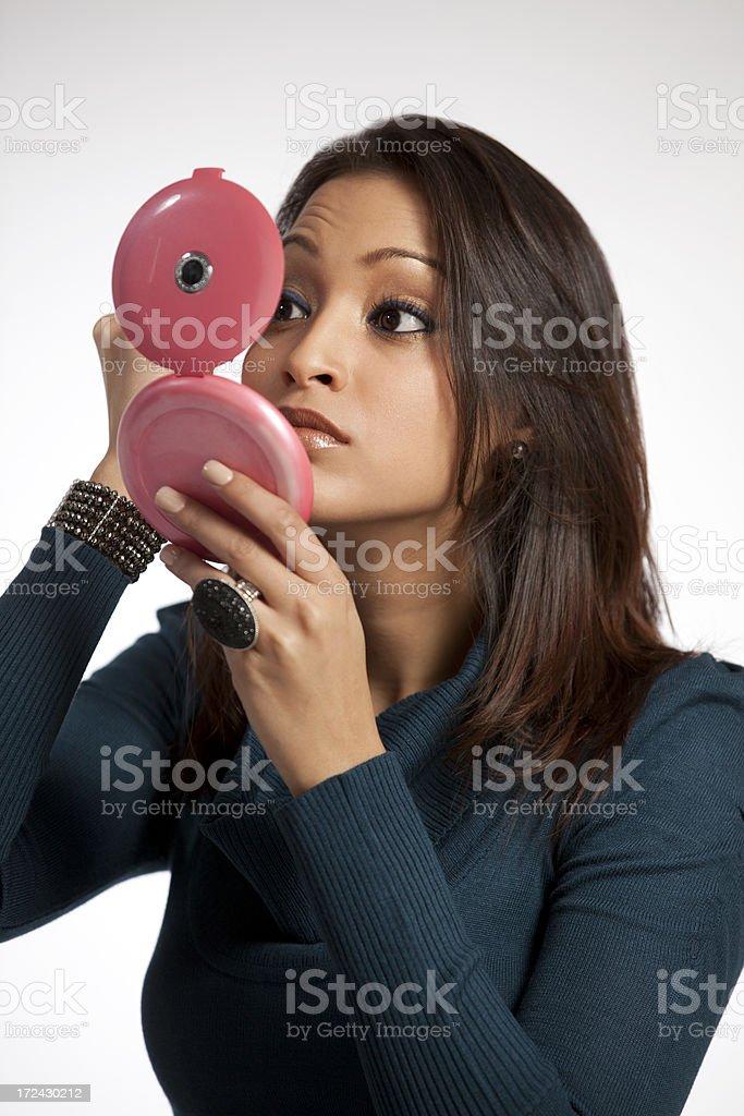 Beautiful Woman Applies Make Up royalty-free stock photo