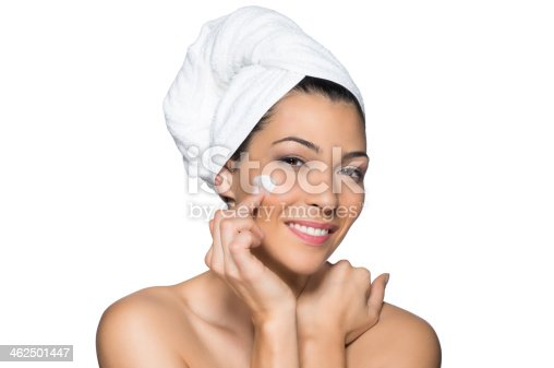 istock Beautiful Woman Applies Moisturizer to Her Face 462501447
