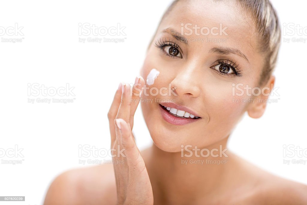 Beautiful woman applying cream stock photo