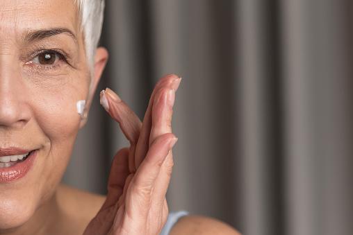 istock Beautiful woman applying face cream 1130302977