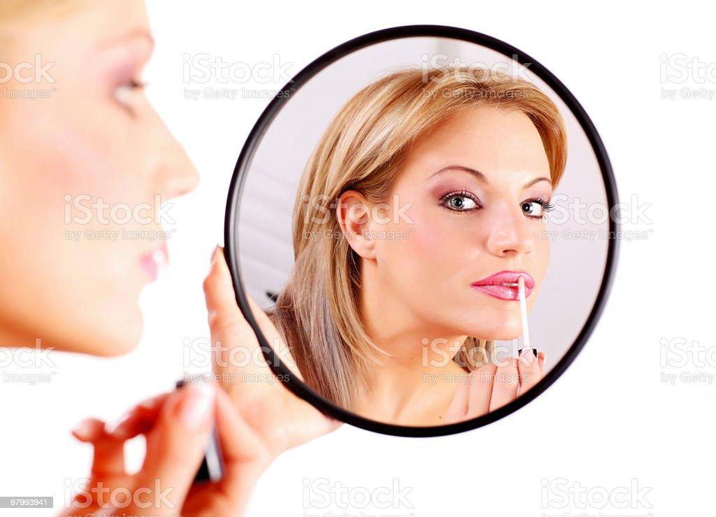 Beautiful woman applying lipstick. royalty-free stock photo
