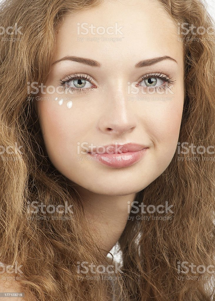 Beautiful woman applying moisturizing cream royalty-free stock photo