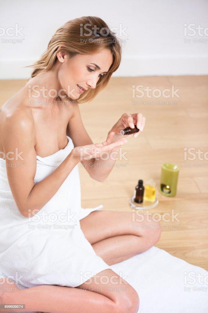 beautiful  woman applying oil stock photo