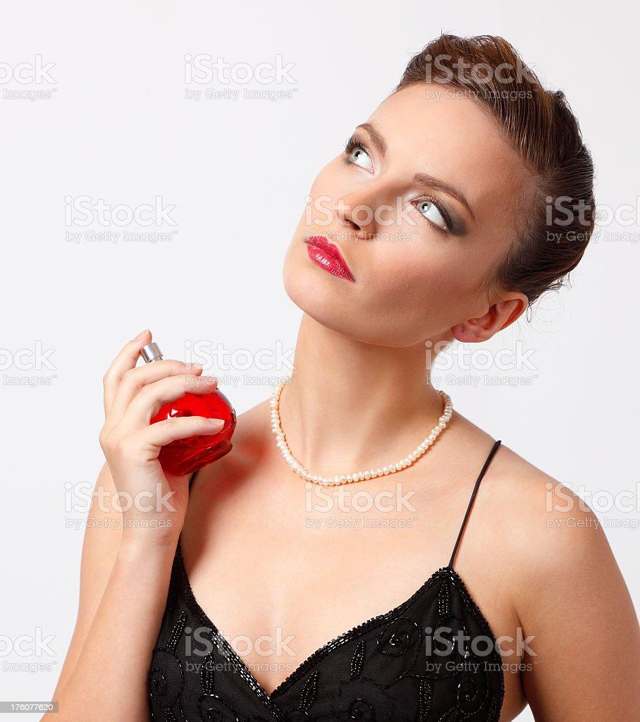 Beautiful woman applying perfume on her neck royalty-free stock photo