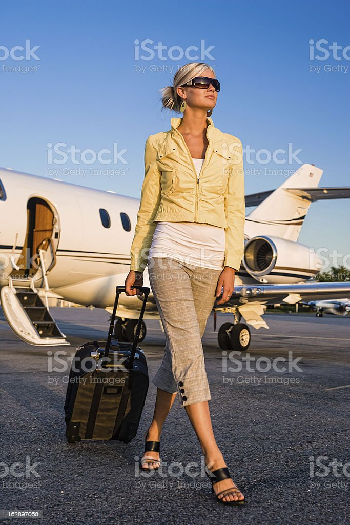 Beautiful Woman Arriving at Airport stock photo