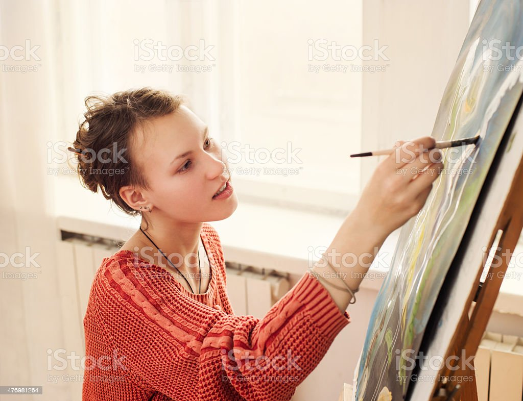 Beautiful woman artist drawing her picture stock photo