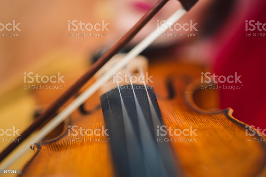 Beautiful woman artist playing the violin on the stage. stock photo