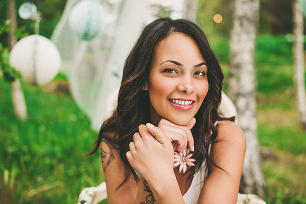Beautiful woman at a garden party stock photo