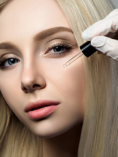 beautiful woman at beauty shop - serum stock photos and pictures