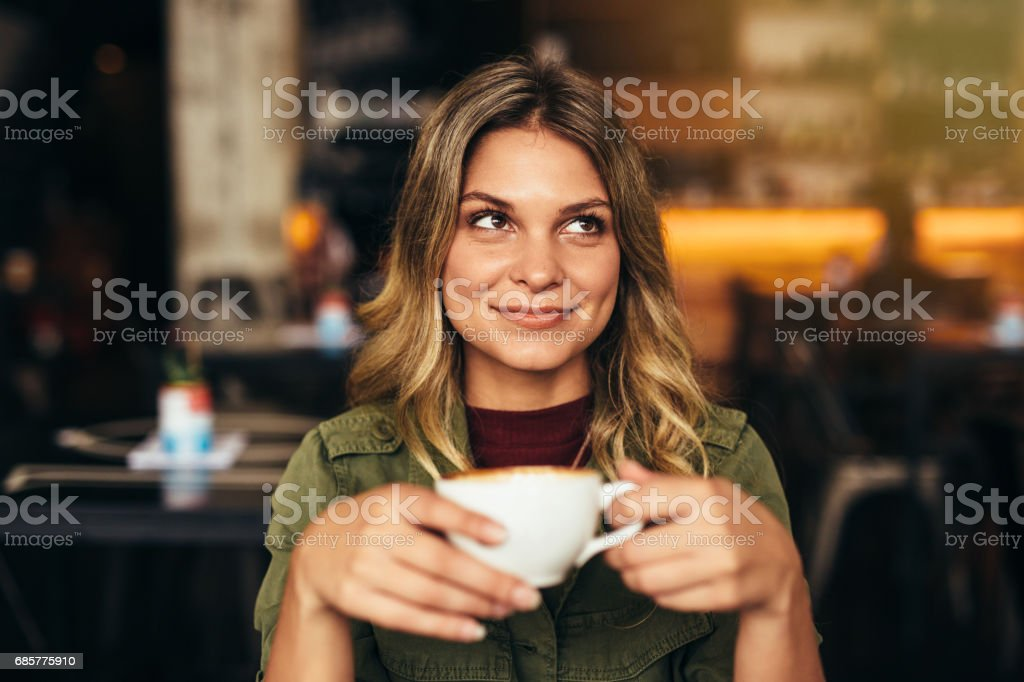 Beautiful woman at cafe with cup of coffee - foto de acervo
