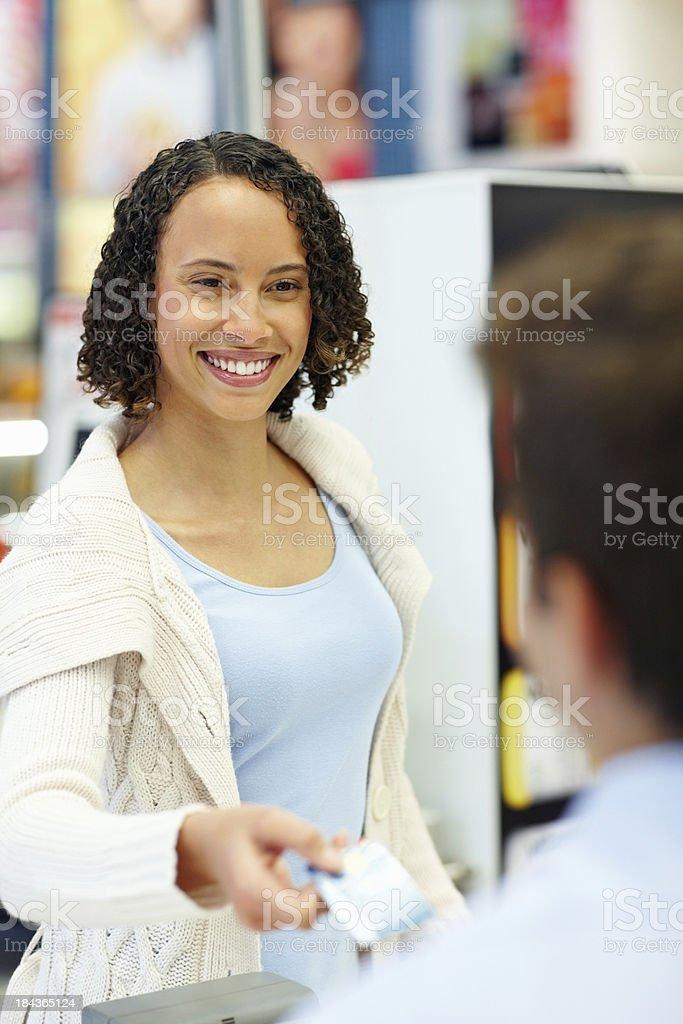 Beautiful woman at cash counter royalty-free stock photo