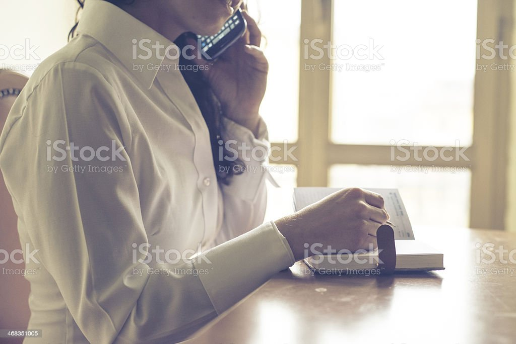 beautiful woman at home writing and working royalty-free stock photo