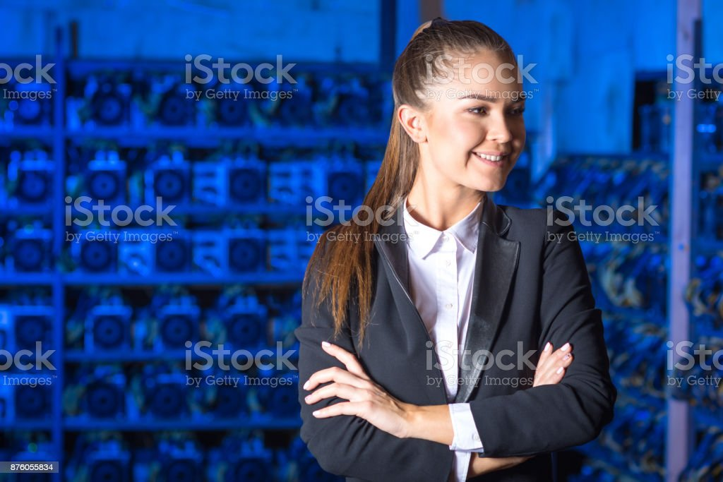 Beautiful woman at mining farm stock photo