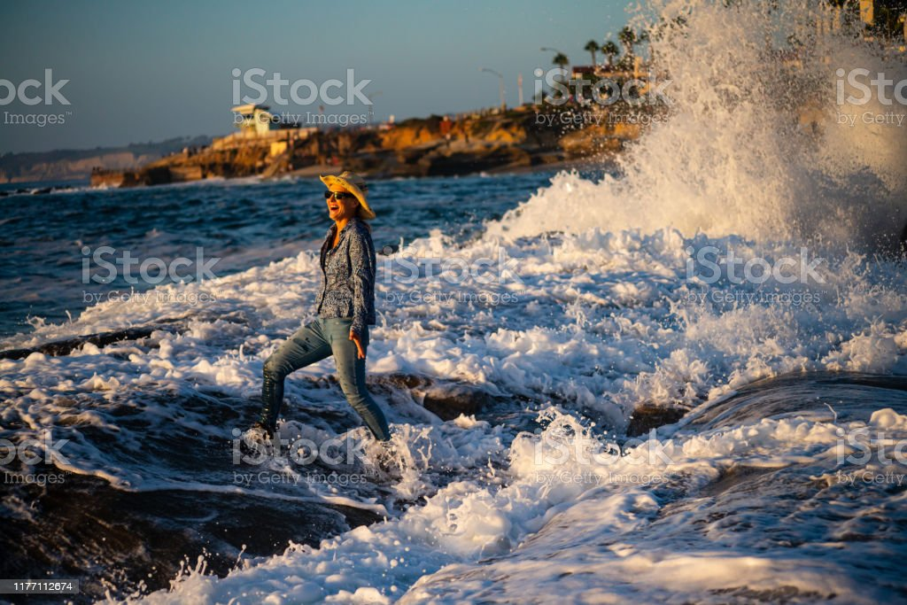 Beautiful woman at the beach Beautiful woman at La Jolla tide pools California. Adult Stock Photo