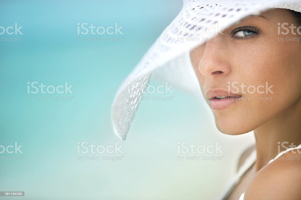 Beautiful woman at the beach stock photo