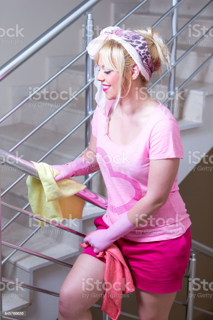 Beautiful woman at the cleaning stock photo