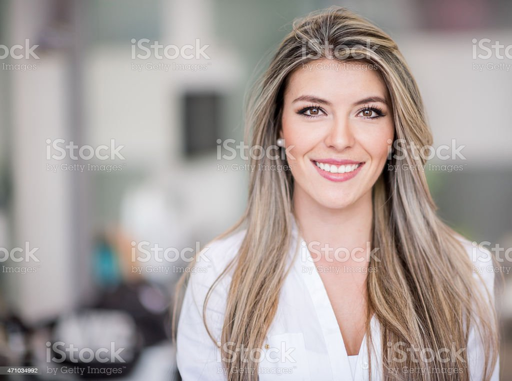 Beautiful woman at the hairdresser stock photo