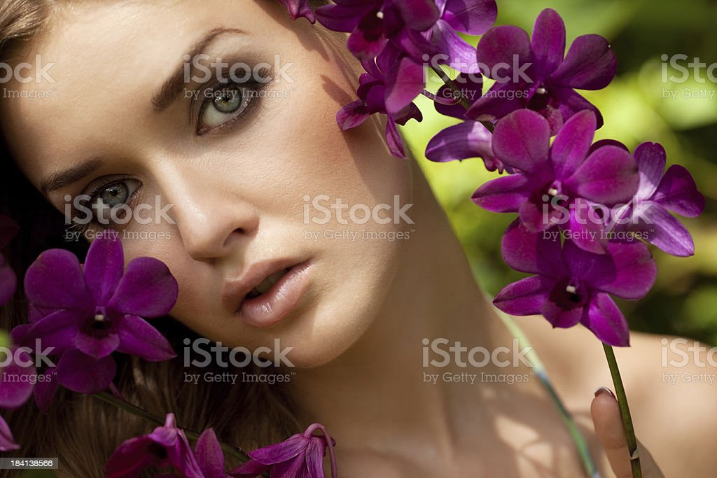 Beautiful woman at the orchid park royalty-free stock photo