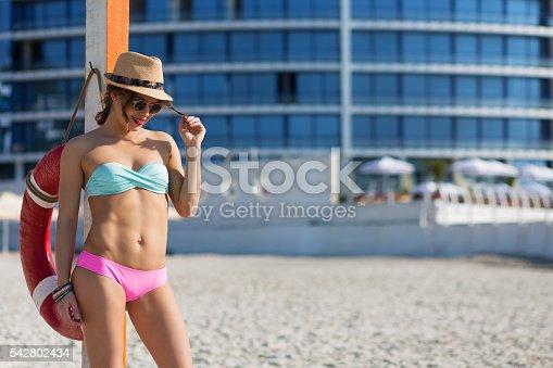1155046257istockphoto Beautiful woman at the summer beach 542802434