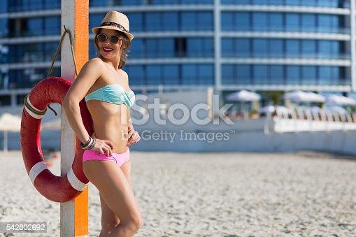 1155046257istockphoto Beautiful woman at the summer beach 542802692