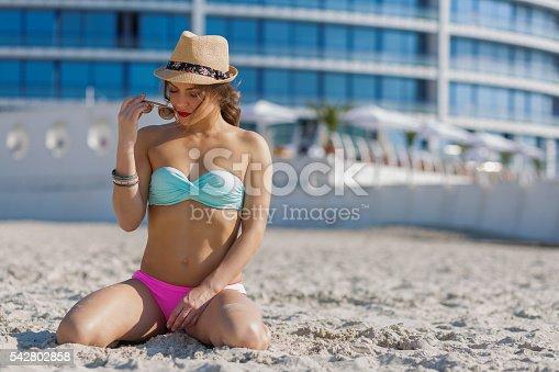 1155046257istockphoto Beautiful woman at the summer beach 542802858
