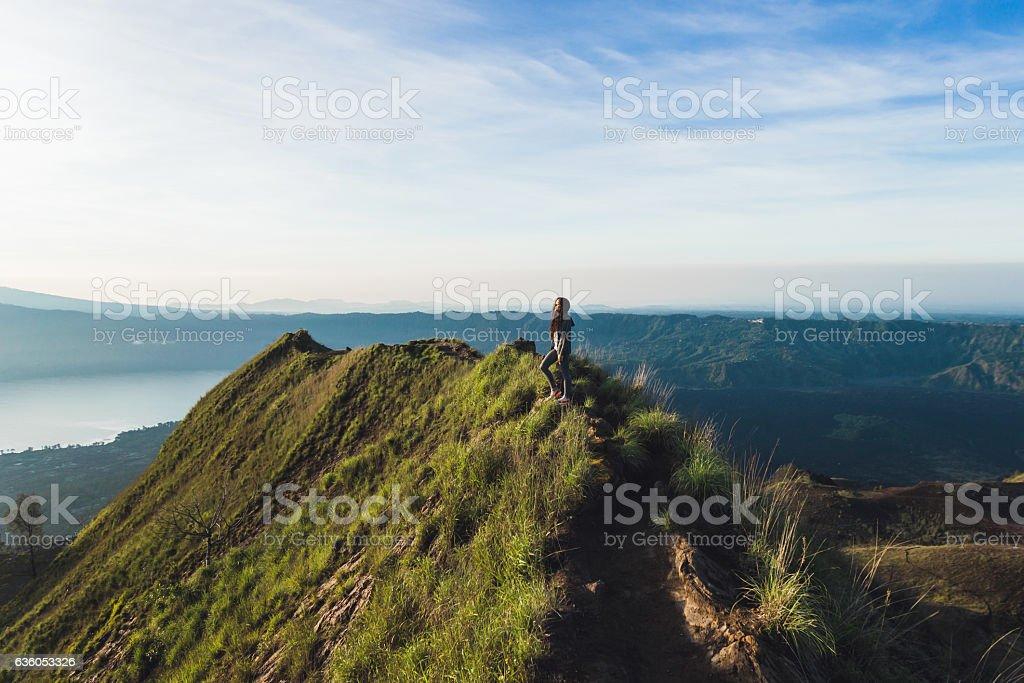 Beautiful woman at the top of Mount Batur, Bali, Indonesia stock photo