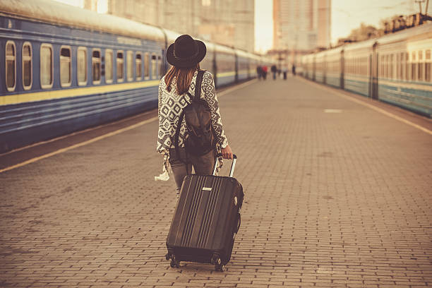 Beautiful woman at the train station - Photo