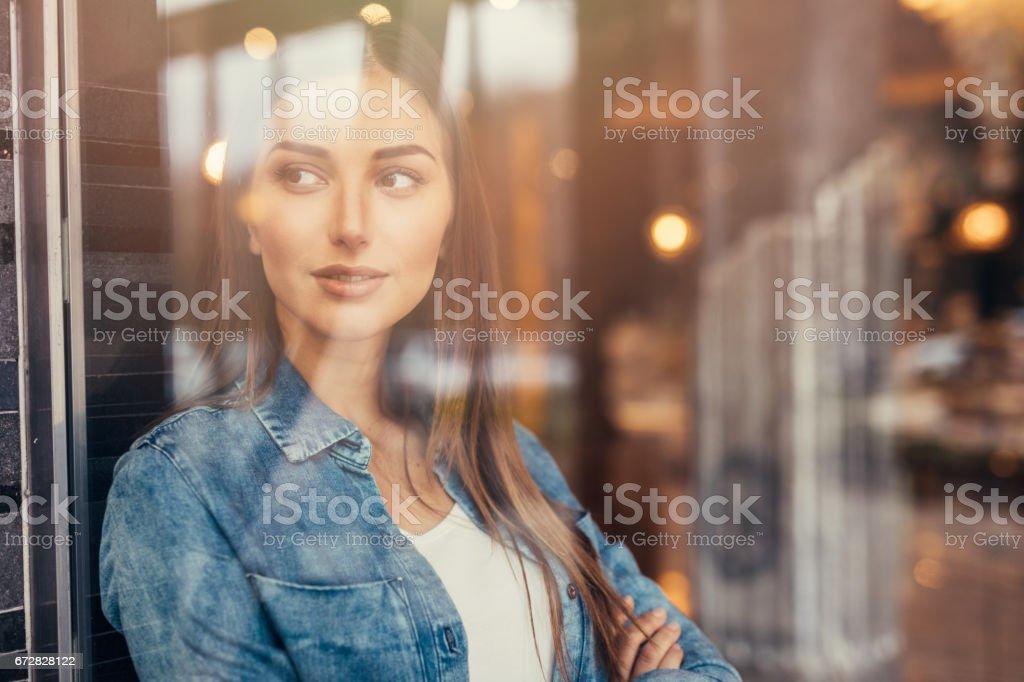Beautiful woman at the window stock photo