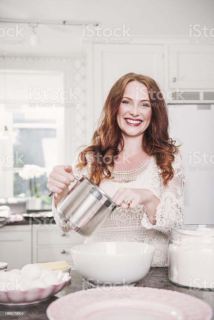 Beautiful woman baking royalty-free stock photo