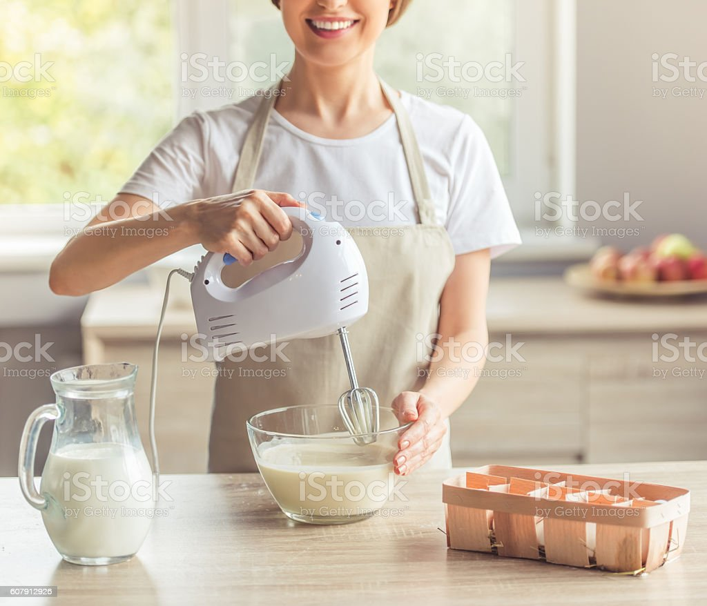 Beautiful woman baking stock photo