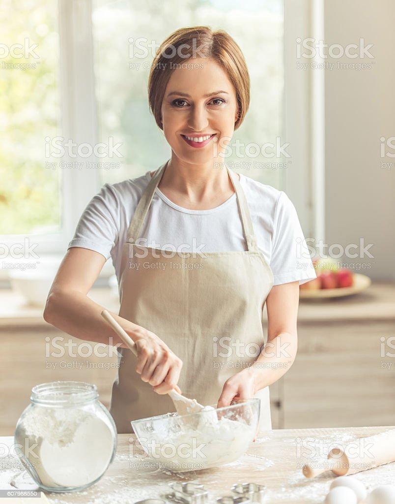 Beautiful woman baking stock photo