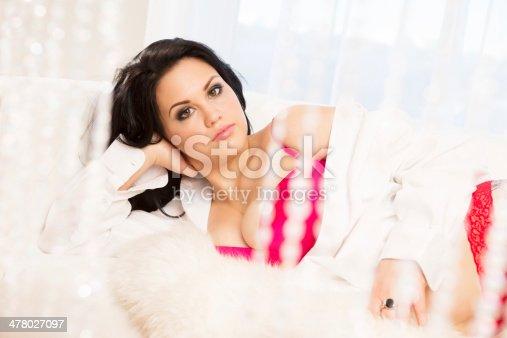 istock Beautiful woman behind crystal curtain 478027097
