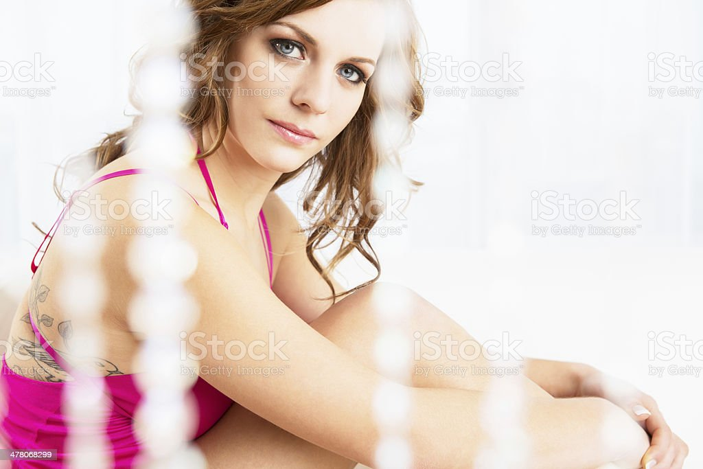 Beautiful woman behind crystal curtain royalty-free stock photo