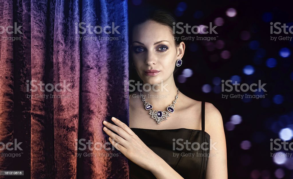 Beautiful woman behind the curtain royalty-free stock photo