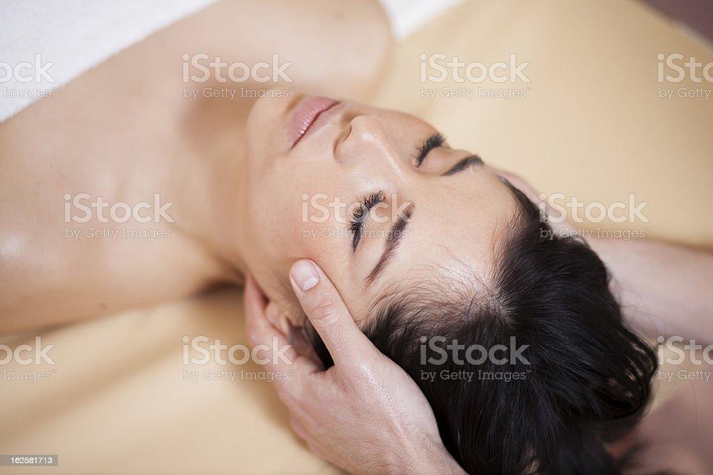 Beautiful woman being pampered at a spa stock photo