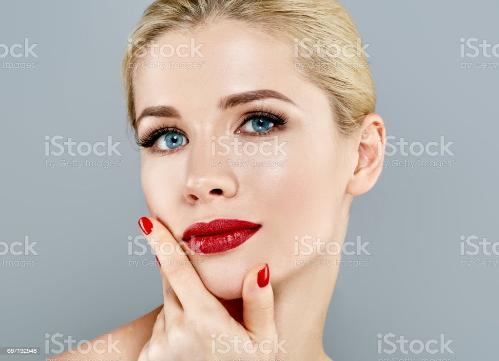 Beautiful Woman Blond face Portrait. Beautiful Spa model Girl with Perfect Fresh Clean Skin. Blonde female smiling. stock photo