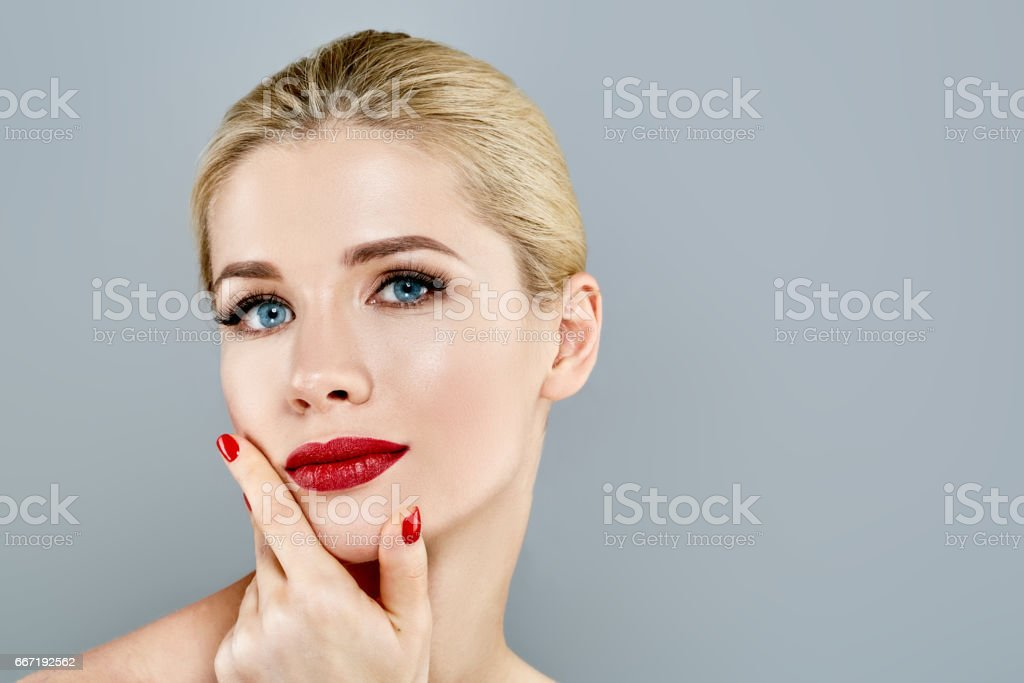 Beautiful Woman Blond face Portrait. Beautiful Spa model Girl with Perfect Fresh Clean Skin. stock photo